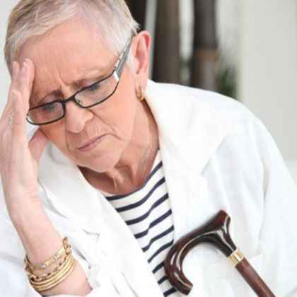 Elderly woman with a headache